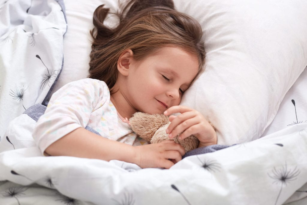 Child sleeping after solving bedwetting problem